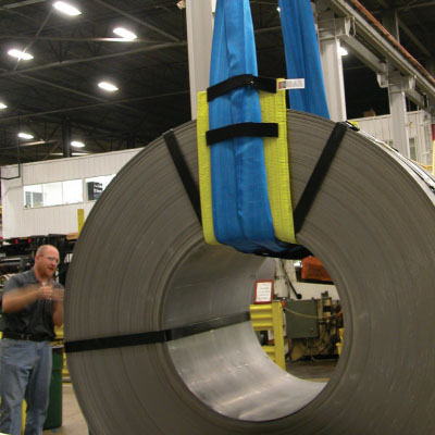 a large load held up by a sling with sling protection equipment and wear pads